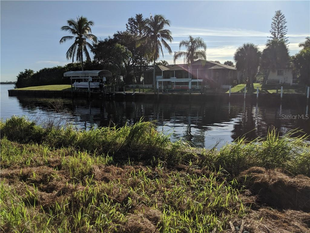 View to the end of the canal to the left. - Vacant Land for sale at 2400 Vance Ter, Port Charlotte, FL 33981 - MLS Number is D6109360