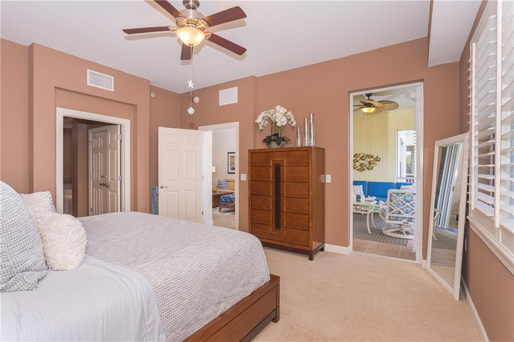 Master Bedroom that has access to your private Lanai - Condo for sale at 8561 Amberjack Cir #202, Englewood, FL 34224 - MLS Number is D6109771