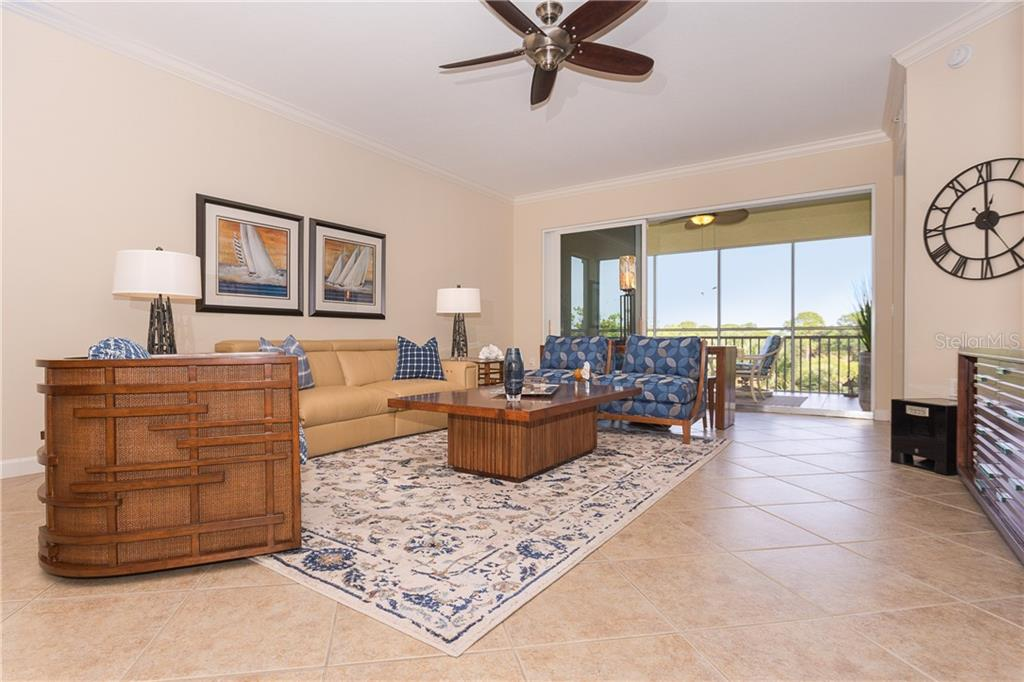 Great Room with views and your extended outside living - Condo for sale at 8561 Amberjack Cir #202, Englewood, FL 34224 - MLS Number is D6109771