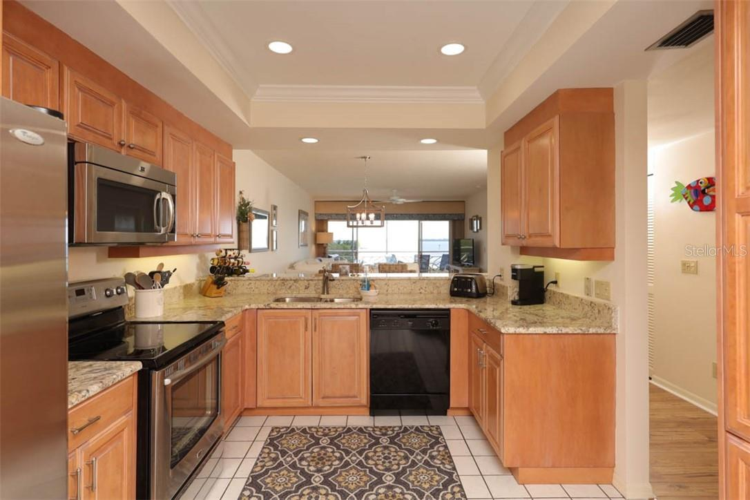 Kitchen - Condo for sale at 11000 Placida Rd #306, Placida, FL 33946 - MLS Number is D6110298