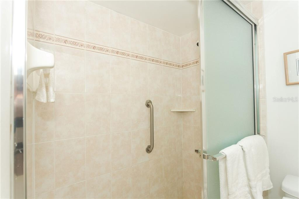 Mater bath has a large walk-in shower - Condo for sale at 1551 Beach Rd #412, Englewood, FL 34223 - MLS Number is D6110828