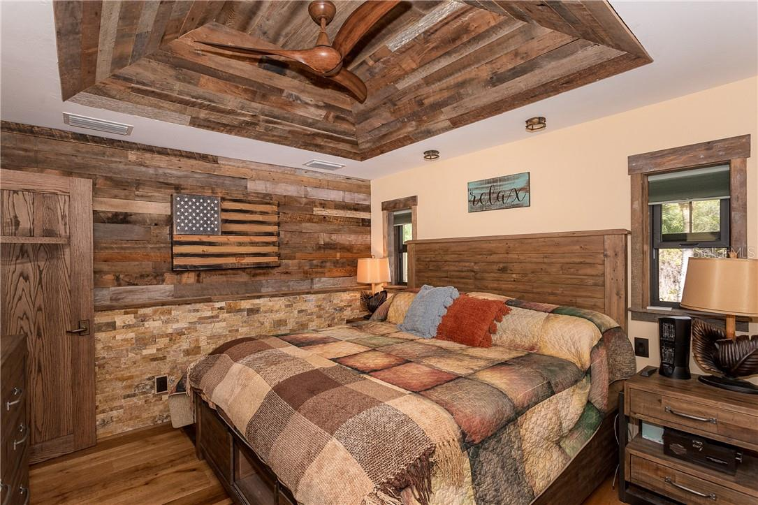 Custom barnwood ceiling accented with barnwood/stone wall - Single Family Home for sale at 1199 Seahorse Ln, Englewood, FL 34224 - MLS Number is D6110877