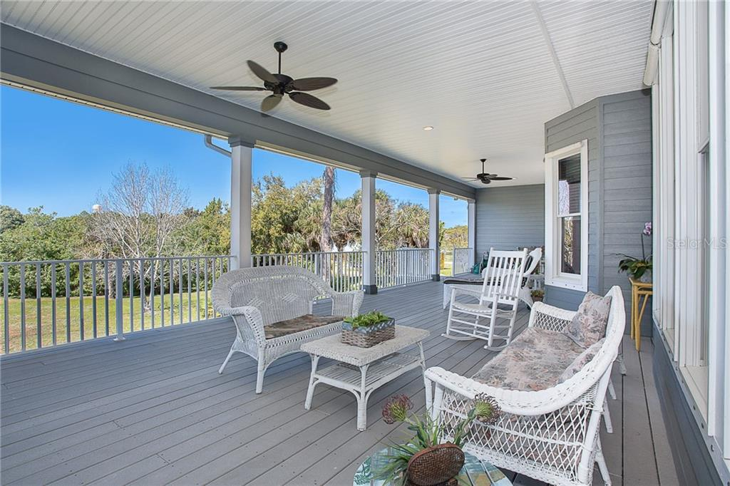 Huge porch overlooking the back yard - Single Family Home for sale at 550 S Oxford Dr, Englewood, FL 34223 - MLS Number is D6111512
