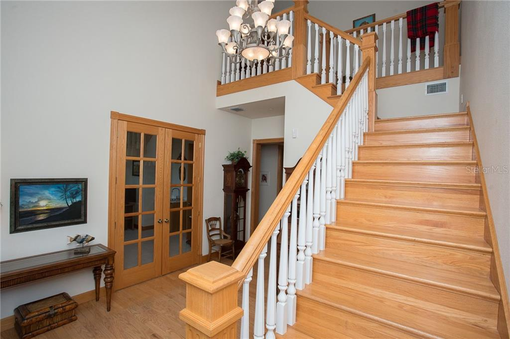 Beautiful stairs - all of the woodworking is in immaculate condition! - Single Family Home for sale at 550 S Oxford Dr, Englewood, FL 34223 - MLS Number is D6111512