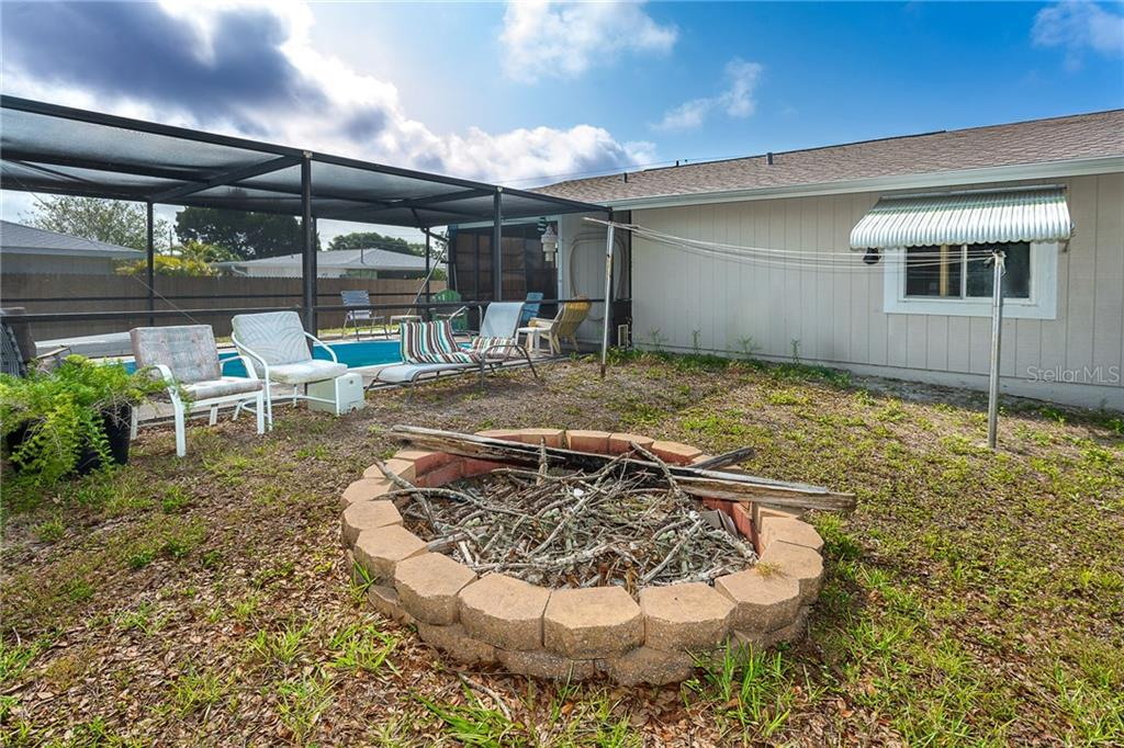 Fire pit in the back yard - Single Family Home for sale at 140 Church Ave, Englewood, FL 34223 - MLS Number is D6111951