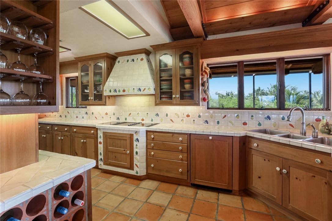 Enchanting tile work on display in the kitchen - Single Family Home for sale at 4090 Loomis Ave, Boca Grande, FL 33921 - MLS Number is D6112331