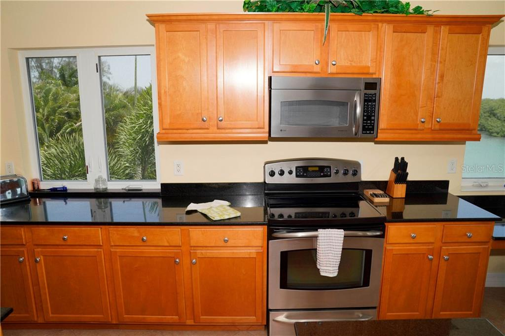 Kitchen View - Condo for sale at 2245 N Beach Rd #304, Englewood, FL 34223 - MLS Number is D6112346
