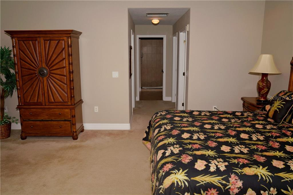 Master bedroom w/walkway into master bath.  Walk-in closets on both sides. - Condo for sale at 2245 N Beach Rd #304, Englewood, FL 34223 - MLS Number is D6112346