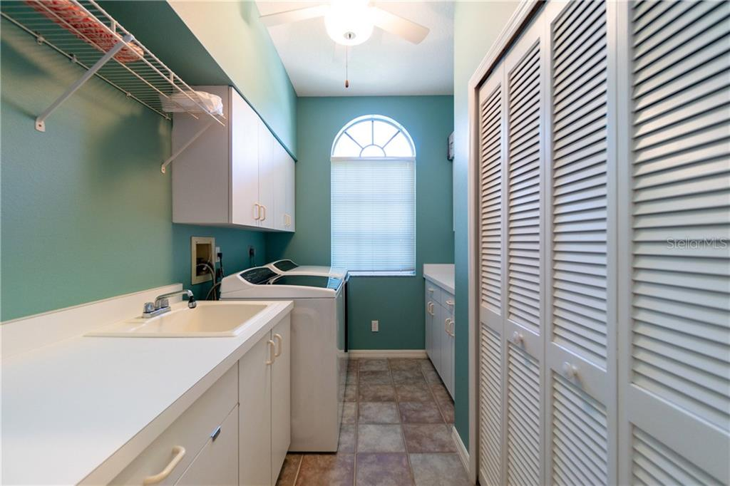 Laundry room has built in cabinetry and sink. - Single Family Home for sale at 280 Capstan Dr, Placida, FL 33946 - MLS Number is D6113118