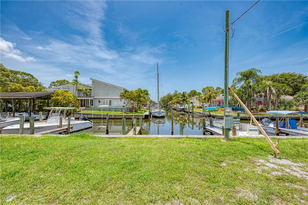 BOAT DOCK LOT IS DIRECTLY IN FRONT OF THE SALE BOAT.  DOCK IS TO THE LEFT. - Single Family Home for sale at 8171 Robert St #B106, Englewood, FL 34224 - MLS Number is D6113242
