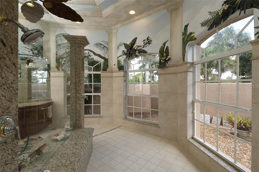Private Garden Outside Master Bath - Single Family Home for sale at 9300 Hialeah Ter, Port Charlotte, FL 33981 - MLS Number is D6113597