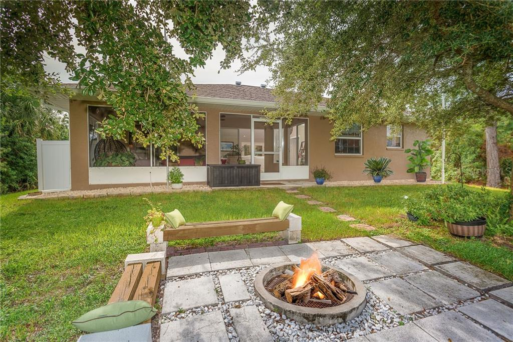 On cooler evenings, enjoy time with family and friends around your own private fire pit - Single Family Home for sale at 185 Apollo Dr, Rotonda West, FL 33947 - MLS Number is D6113690