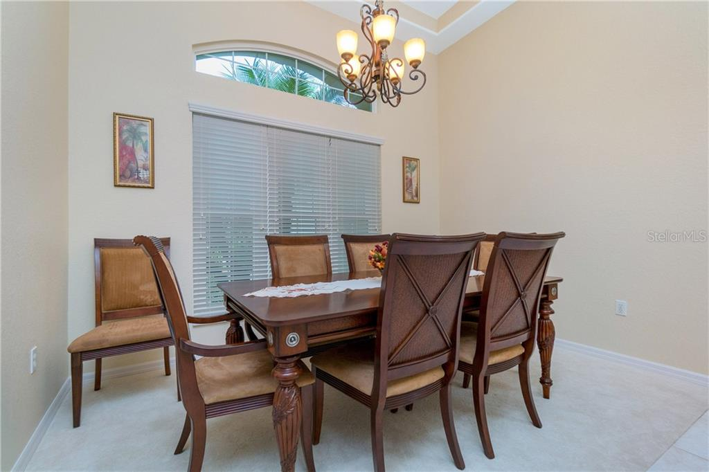 Another view of the formal dining area. - Single Family Home for sale at 439 Boundary Blvd, Rotonda West, FL 33947 - MLS Number is D6114162