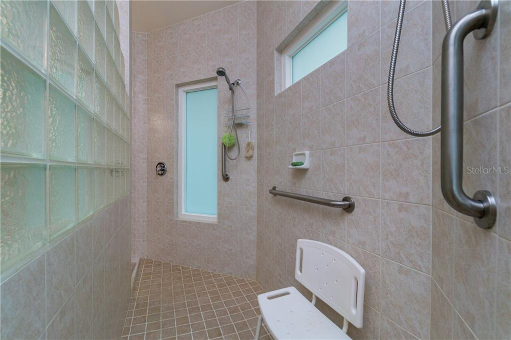 Master bath walk in shower. - Single Family Home for sale at 439 Boundary Blvd, Rotonda West, FL 33947 - MLS Number is D6114162