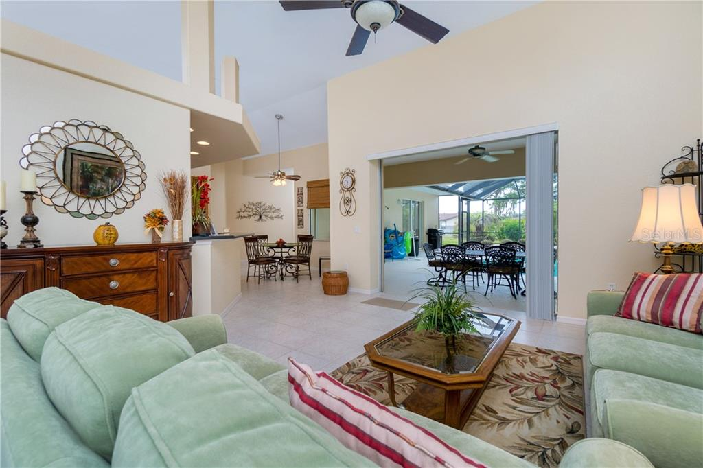 Formal living room has triple sliding glass doors to the lanai. - Single Family Home for sale at 439 Boundary Blvd, Rotonda West, FL 33947 - MLS Number is D6114162