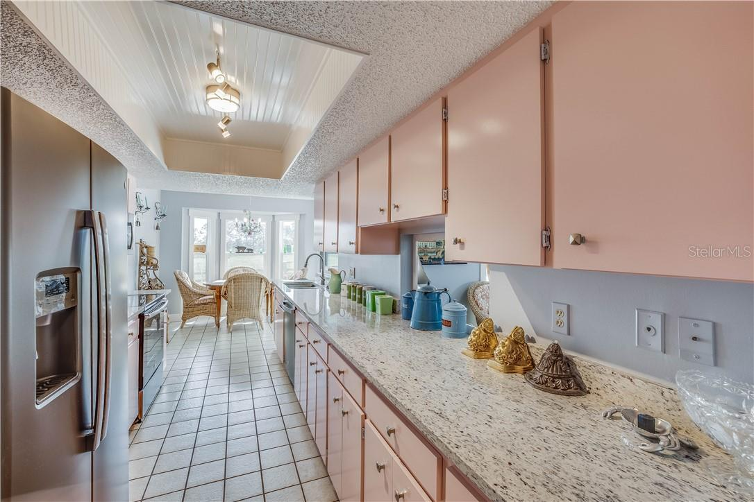 Kitchen with granite, tray ceiling and breakfast area - Single Family Home for sale at 13000 Gasparilla Rd, Placida, FL 33946 - MLS Number is D6114315