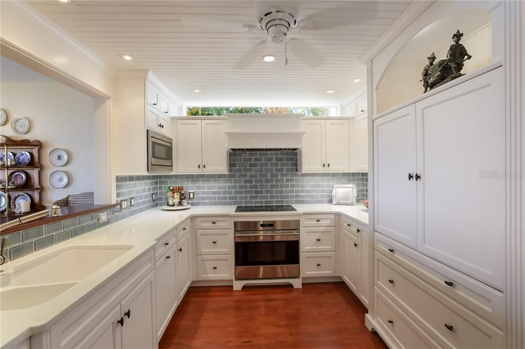Custom kitchen with transom window - Single Family Home for sale at 561 Buttonwood Bay Dr, Boca Grande, FL 33921 - MLS Number is D6114322