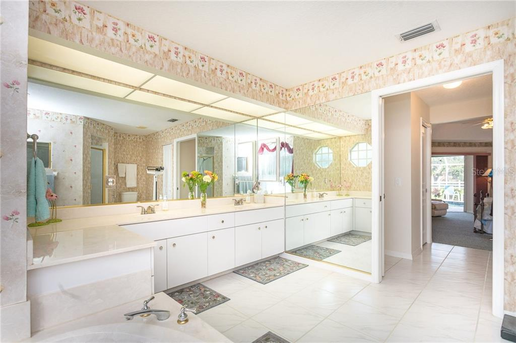 The huge master bathroom - Single Family Home for sale at 1720 Larson St, Englewood, FL 34223 - MLS Number is D6114414