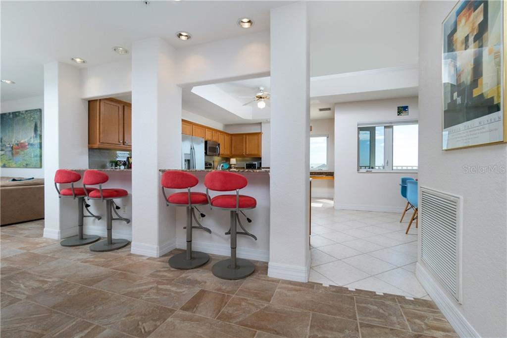 Breakfast or Lunch Bar Looking Into Kitchen - Condo for sale at 2225 N Beach Rd #401, Englewood, FL 34223 - MLS Number is D6114646