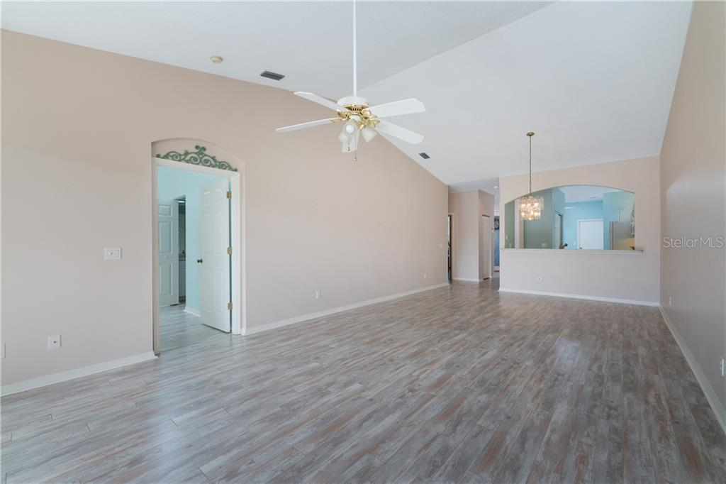 Dining/Living Room Combo - Villa for sale at 849 Tartan Dr #10, Venice, FL 34293 - MLS Number is D6115682