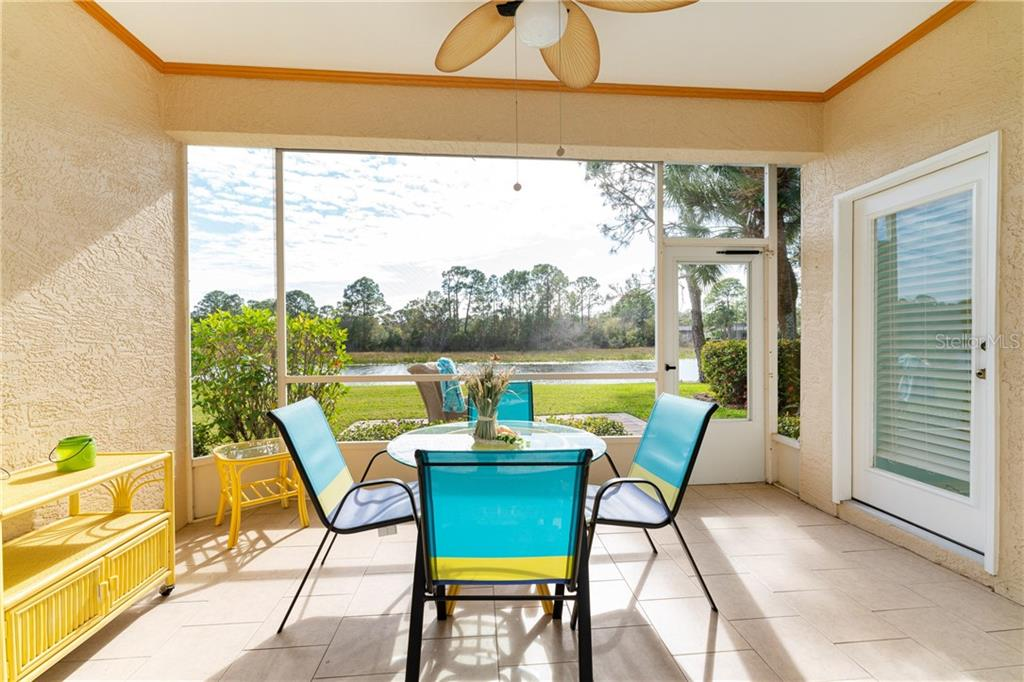 Lanai overlooking pond - Villa for sale at 849 Tartan Dr #10, Venice, FL 34293 - MLS Number is D6115682