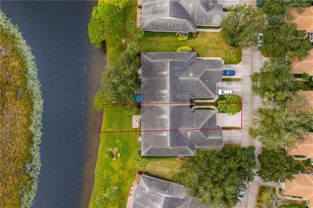 Satellite view of property overlooking pond and preserve - Villa for sale at 849 Tartan Dr #10, Venice, FL 34293 - MLS Number is D6115682