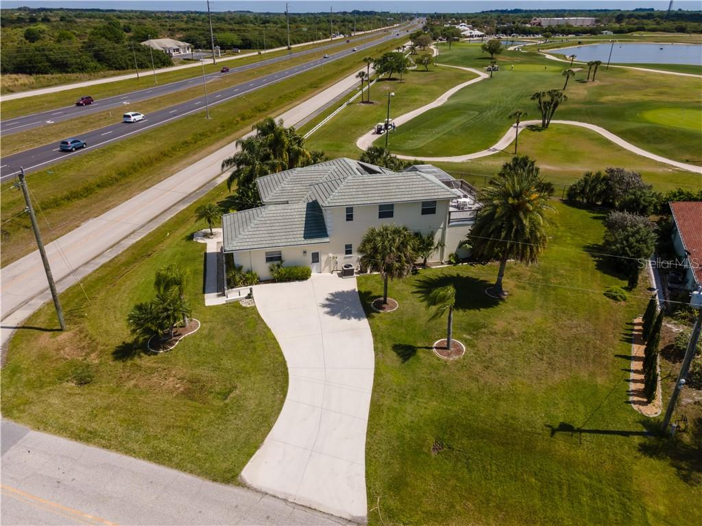 View looking east. - Single Family Home for sale at 12307 S Access Rd, Port Charlotte, FL 33981 - MLS Number is D6117140