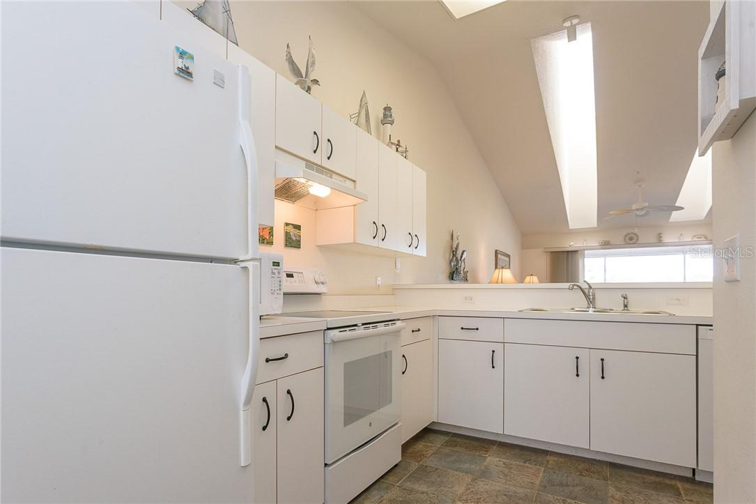 Light, bright kitchen offers plenty of prep space and cabinetry - Condo for sale at 6610 Gasparilla Pines Blvd #229, Englewood, FL 34224 - MLS Number is D6117434
