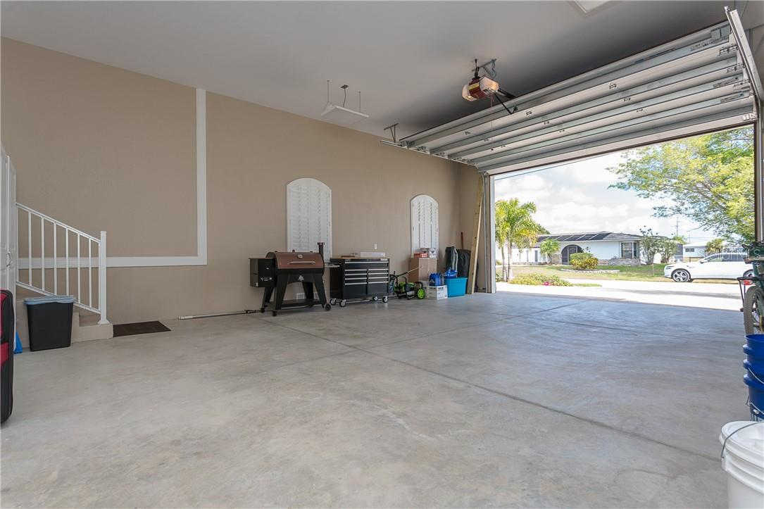 Extra large garage is fully insulated and climate controlled, with a commercial ice maker too - Single Family Home for sale at 145 Leland St Se, Port Charlotte, FL 33952 - MLS Number is D6117438