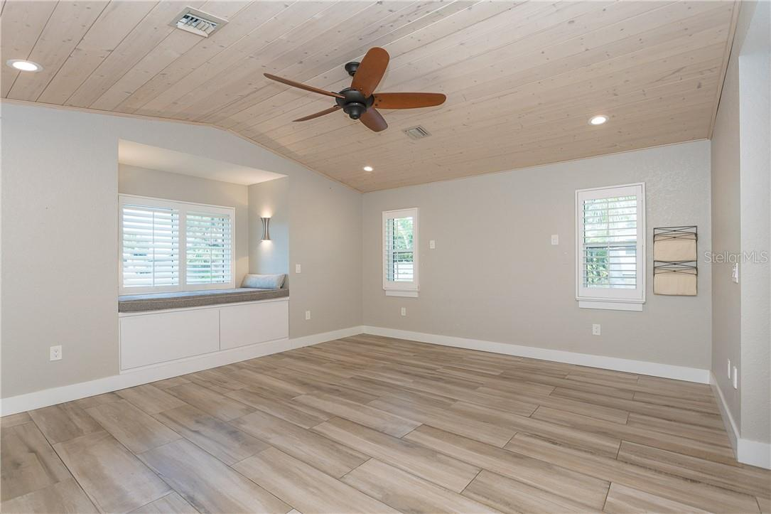 Master Bedroom with amazing flooring and Shiplap ceiling.  Add to the luxury with the plantation shutters!! - Single Family Home for sale at 1661 New Point Comfort Rd, Englewood, FL 34223 - MLS Number is D6117712