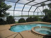This is the view you have of Coral Creek from the pool/spa area.  You can watch the fish jump, the eagles soar and the pelicans dive. - Single Family Home for sale at 450 Coral Creek Dr, Placida, FL 33946 - MLS Number is D5901346