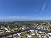 Aerial view of Englewood Isles/Lemon Bay/ Manasota Key Beach from house - Single Family Home for sale at 9 Pine Ridge Way, Englewood, FL 34223 - MLS Number is D5921839