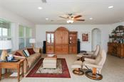 Great Room - Single Family Home for sale at 8089 Antwerp Cir, Port Charlotte, FL 33981 - MLS Number is D5923359