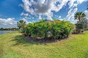 Acera palms surrounding lanai for privacy - Single Family Home for sale at 409 Montelluna Drive, North Venice, FL 34275 - MLS Number is D5923522