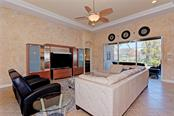 Living room - Single Family Home for sale at 409 Montelluna Drive, North Venice, FL 34275 - MLS Number is D5923522
