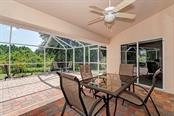 The lanai is perfect for entertaining and is partly under roof.  This area is large enough for a hot tub or if you should decide to build a pool. - Single Family Home for sale at 7256 Holsum St, Englewood, FL 34224 - MLS Number is D6101787