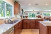 Natural light pours in from very direction through the impact resistant windows.  Views of the private pond and woods are breath taking - Single Family Home for sale at 7339 Hawkins Rd, Sarasota, FL 34241 - MLS Number is D6102762