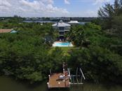 Dock & Back Yard Aerial - Single Family Home for sale at 161 Kettle Harbor Dr, Placida, FL 33946 - MLS Number is D6104075
