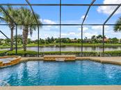 Huge Great Room opens to Lanai with views of Lake.  Hardwood Floors - Single Family Home for sale at 2684 Sable Palm Way, Port Charlotte, FL 33953 - MLS Number is D6104434