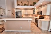 Kitchen with new SS Appliances, opens to Family Room and Dinette. - Single Family Home for sale at 8 Medalist Cir, Rotonda West, FL 33947 - MLS Number is D6104474