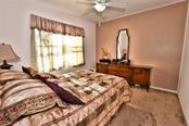 Guest bedroom 1. - Single Family Home for sale at 8 Medalist Cir, Rotonda West, FL 33947 - MLS Number is D6104474