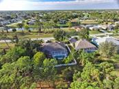 Aerial views of 8 Medalist Cr. - Single Family Home for sale at 8 Medalist Cir, Rotonda West, FL 33947 - MLS Number is D6104474