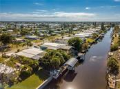 An aerial view of the canal, neighborhood and surrounding area. - Manufactured Home for sale at 1316 Seagull Dr, Englewood, FL 34224 - MLS Number is D6105776