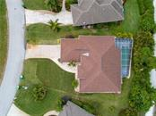 An aerial view of the property which has a private backyard. - Single Family Home for sale at 30 Medalist Way, Rotonda West, FL 33947 - MLS Number is D6106239