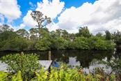 Pop a jig under those mangroves and bring in a nice snook or red …. - Single Family Home for sale at 9033 Allapata Ln, Venice, FL 34293 - MLS Number is D6106356