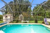 pool/garden view - Single Family Home for sale at 913 Tropical Ave Nw, Port Charlotte, FL 33948 - MLS Number is D6108061