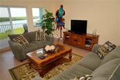 spacious living room w/water views - Condo for sale at 2245 N Beach Rd #304, Englewood, FL 34223 - MLS Number is D6112346