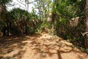 partial underbrush clearing - Vacant Land for sale at 9427 Downing St, Englewood, FL 34224 - MLS Number is D6112667