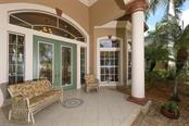 Tiled Front Porch - Single Family Home for sale at 9300 Hialeah Ter, Port Charlotte, FL 33981 - MLS Number is D6113597