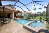SPA AND POOL - Single Family Home for sale at 1944 Coconut Palm Cir, North Port, FL 34288 - MLS Number is D6114523
